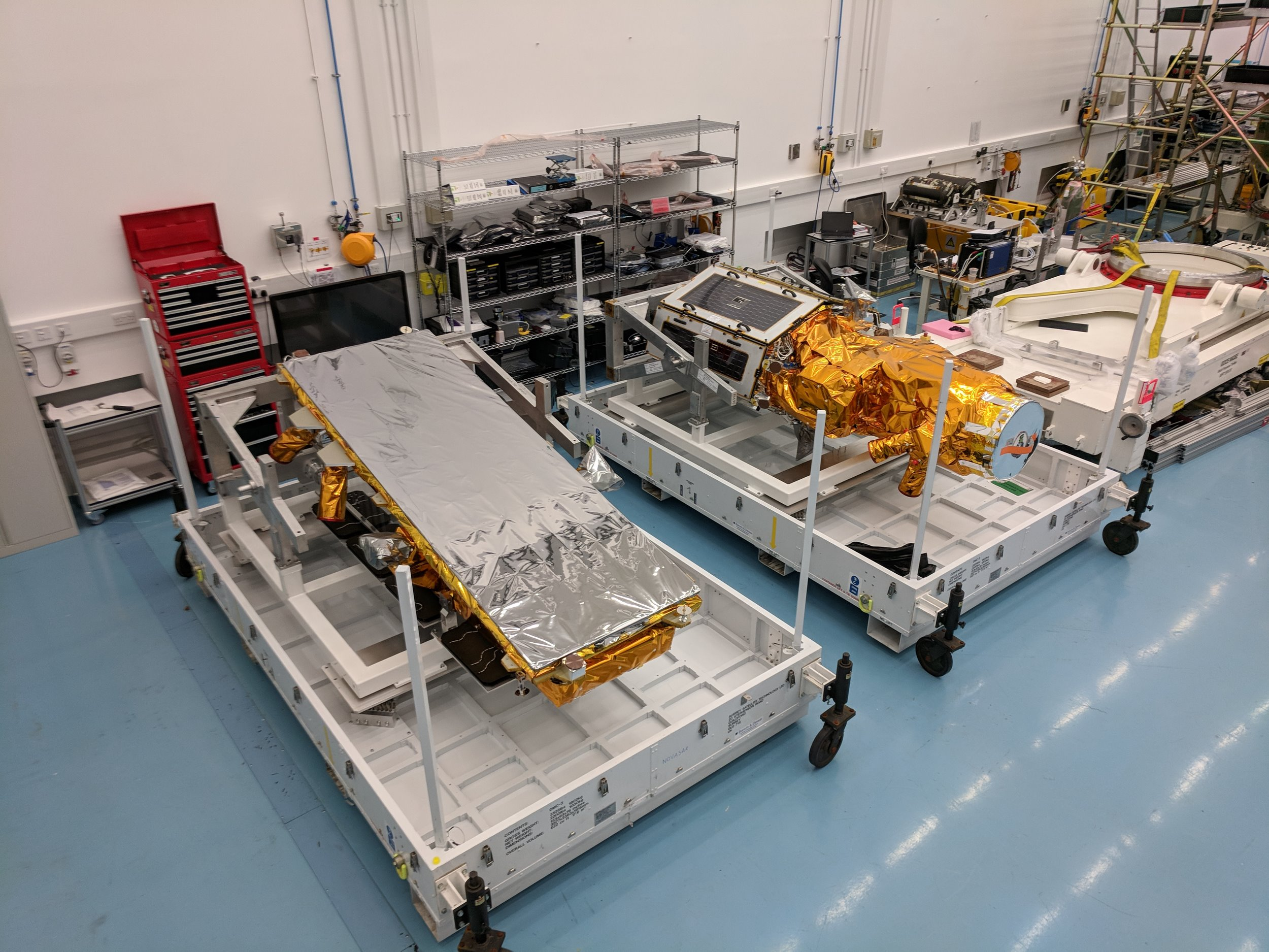 NovaSAR-1 and SSTL S1-4 in flight cases at SSTL, August 2018. Credit SSTL.