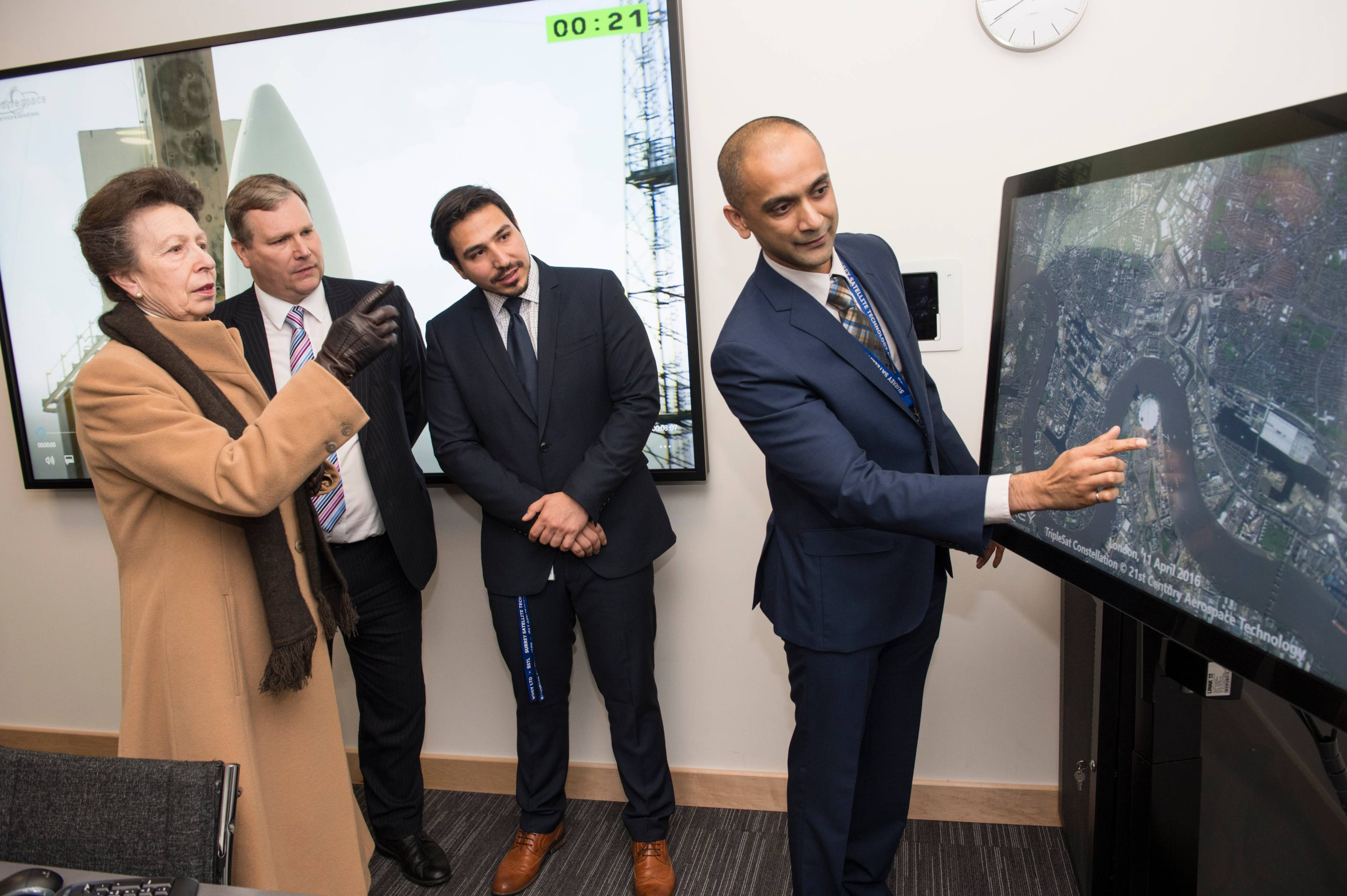 Nimal Navarathinam, Systems Engineer, takes Her Royal Highness on a guided tour of London from space using an interactive image of London taken by one of SSTL's satellites