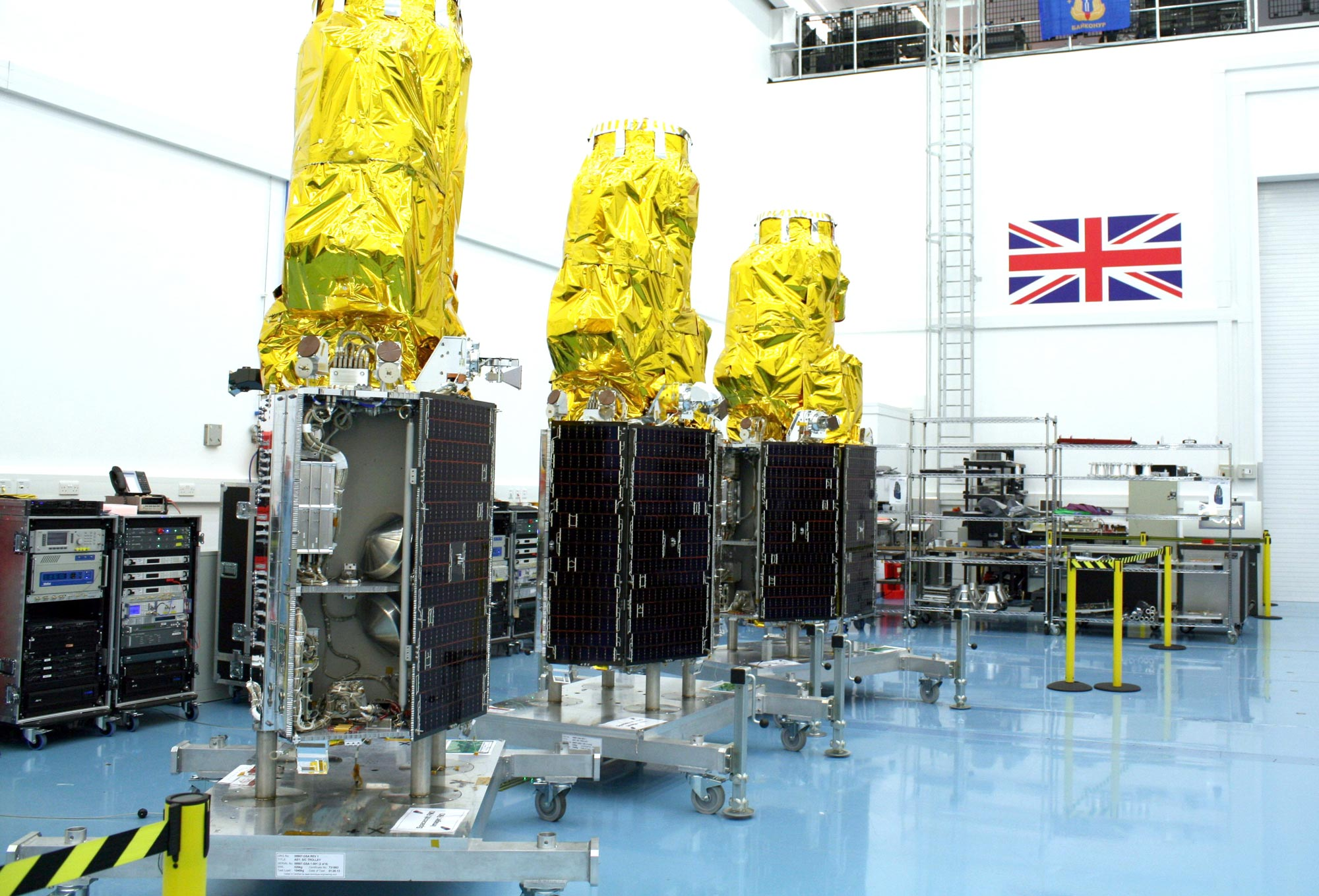 The three DMC3 satellites in SSTL's cleanroom (Guildford, UK) prior to shipping to launch site.