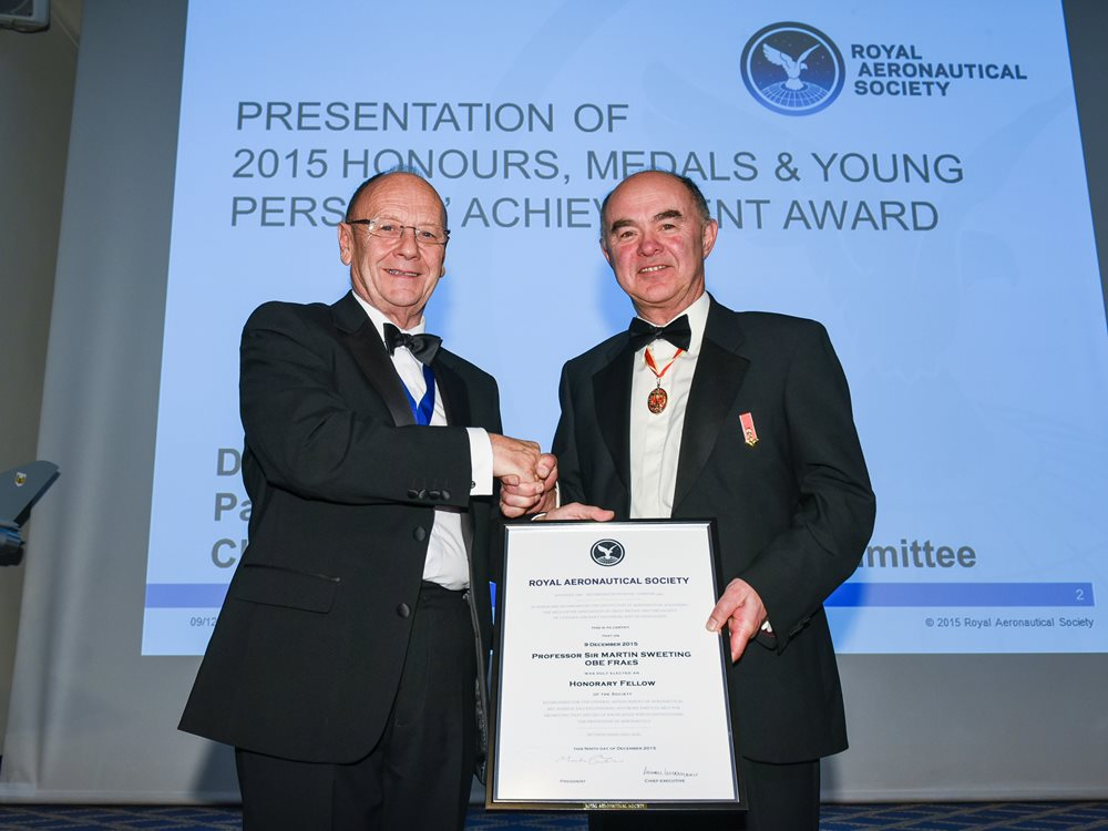 Martin Broadhurst, President of the RAeS, presenting the Honorary Fellowship to Sir Martin Sweeting, on 9 December 2015 at the Society's Headquarters in London