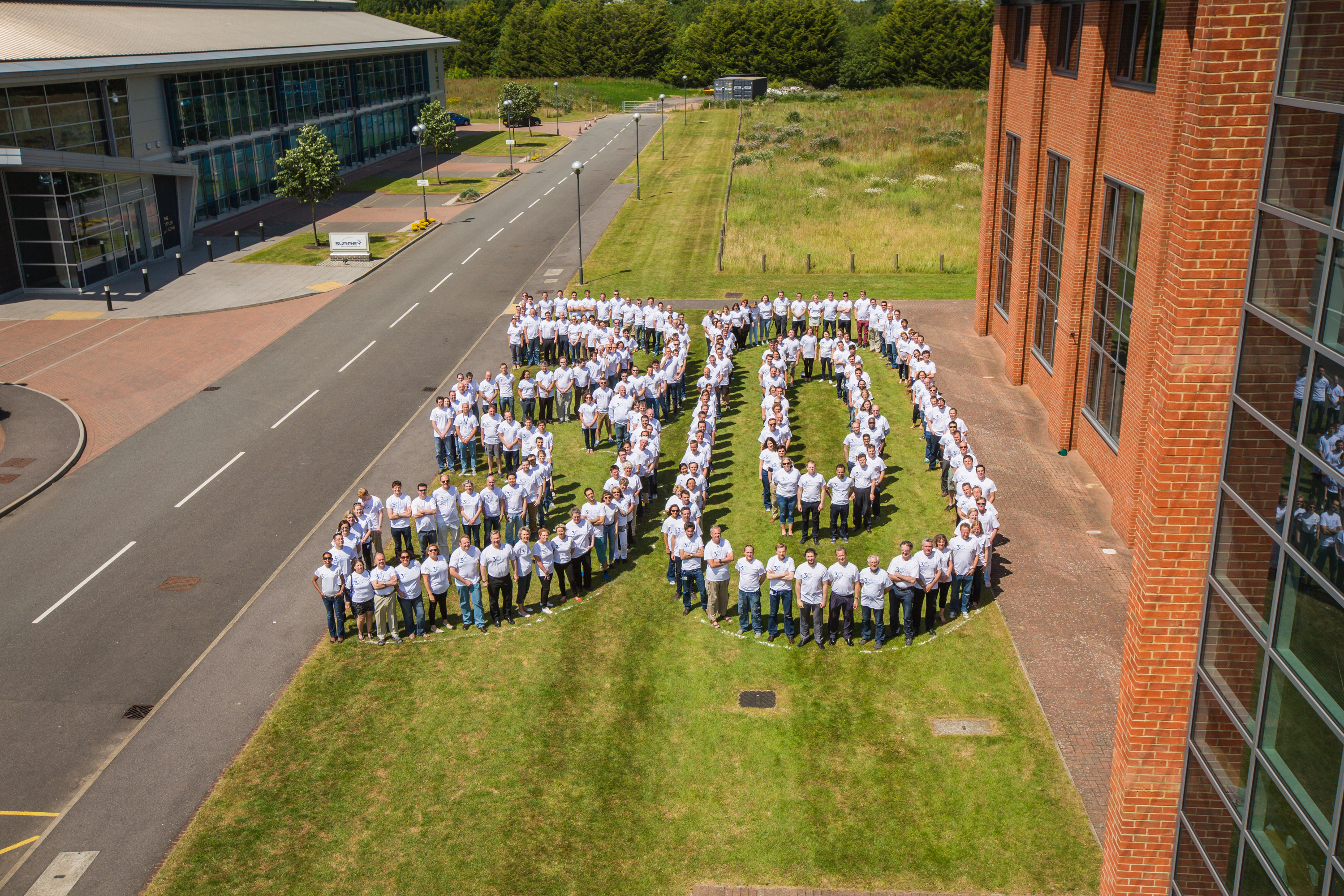 Staff celebrating the Company's 30th Anniversary at the Guildford site