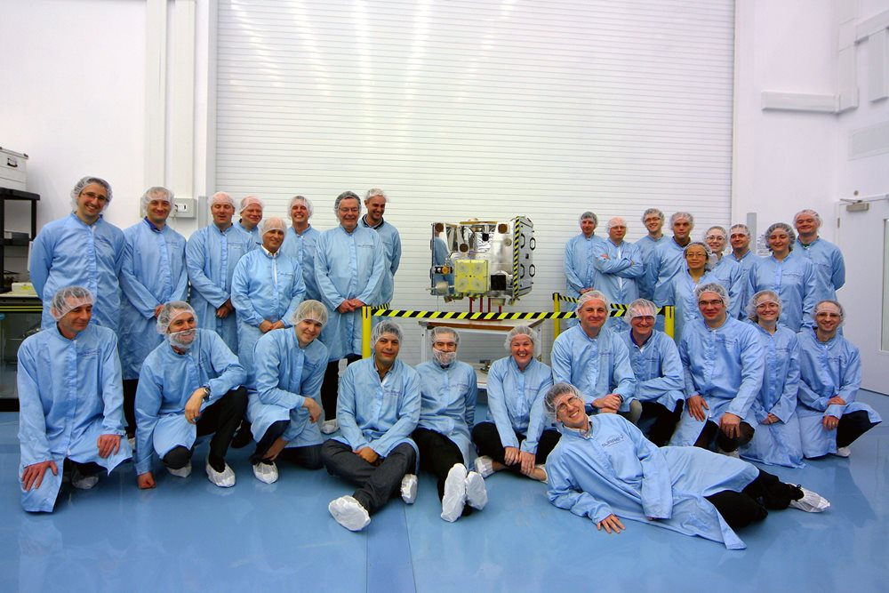 SSTL module design engineers and cleanroom technicians with TechDemoSat-1 in SSTL's cleanroom