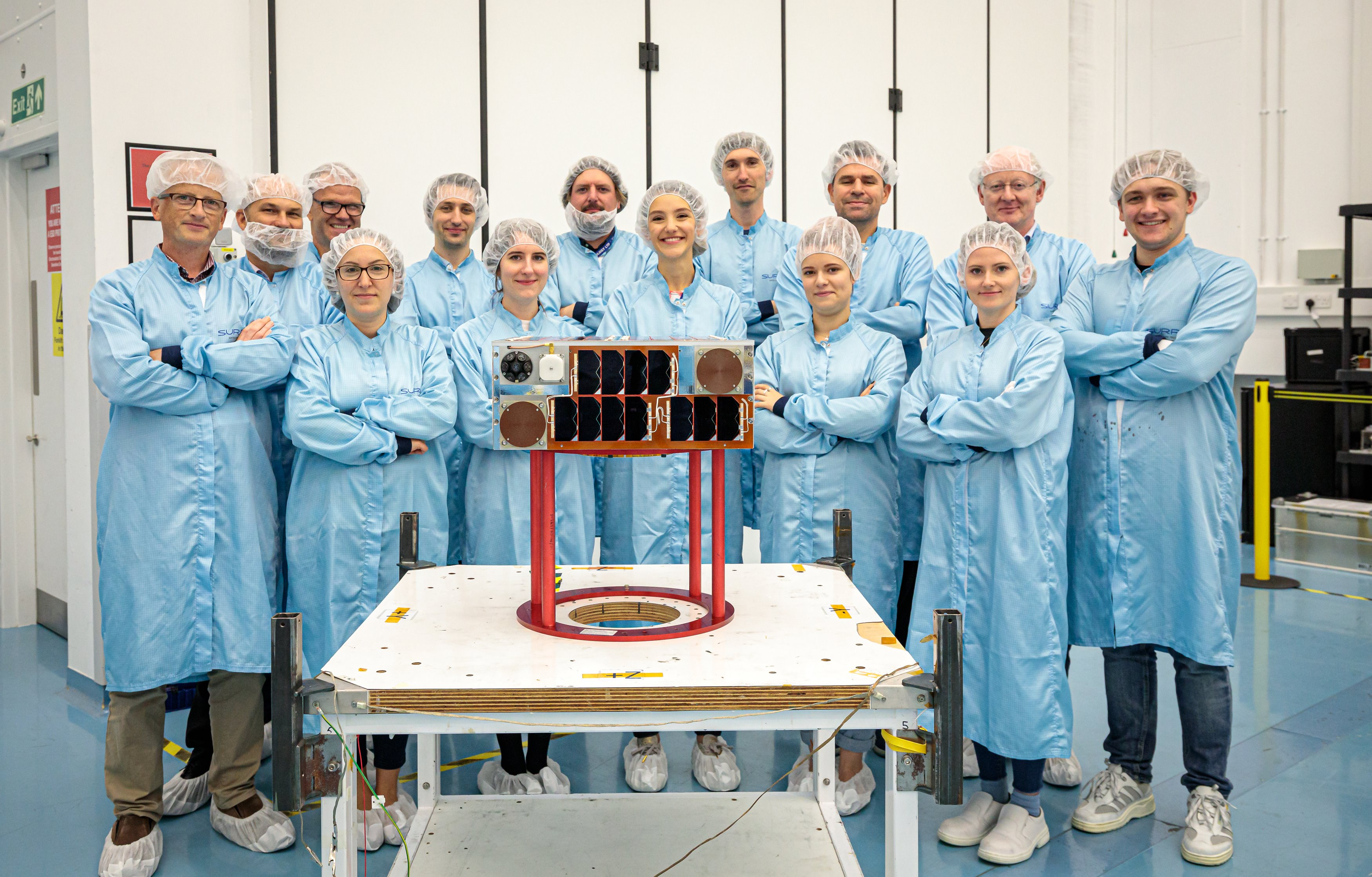ELSA-d Target satellite with SSTL engineering team, October 2019. Credit SSTL/Kathryn Graham