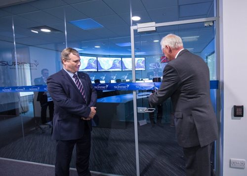 Michael Boyd cutting the ribbon to officially open SSTL's new Spacecraft Operations Centre