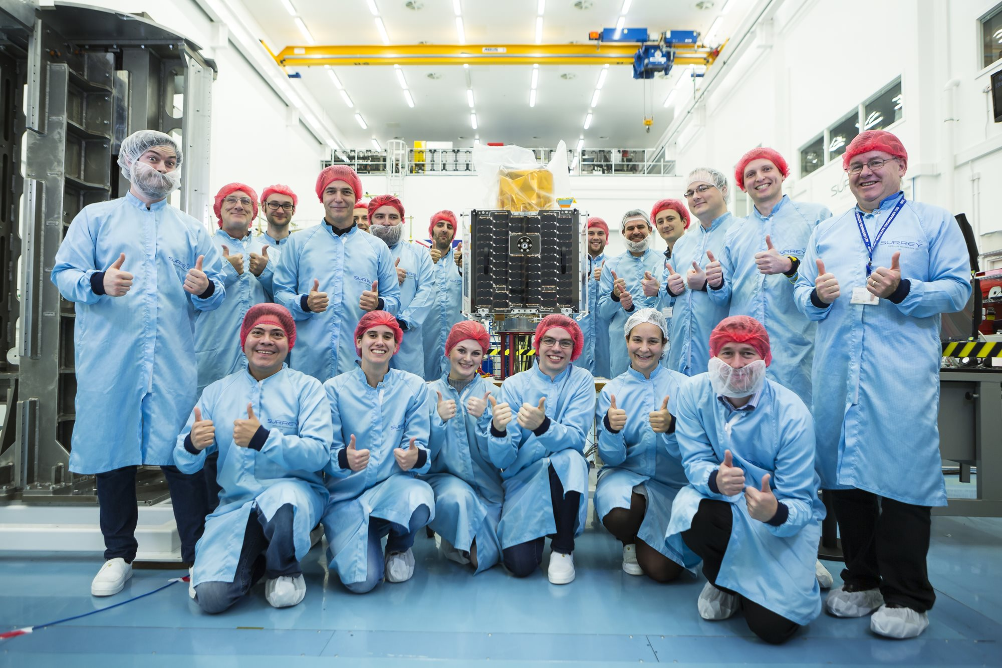 SSTL staff with CARBONITE-2 satellite